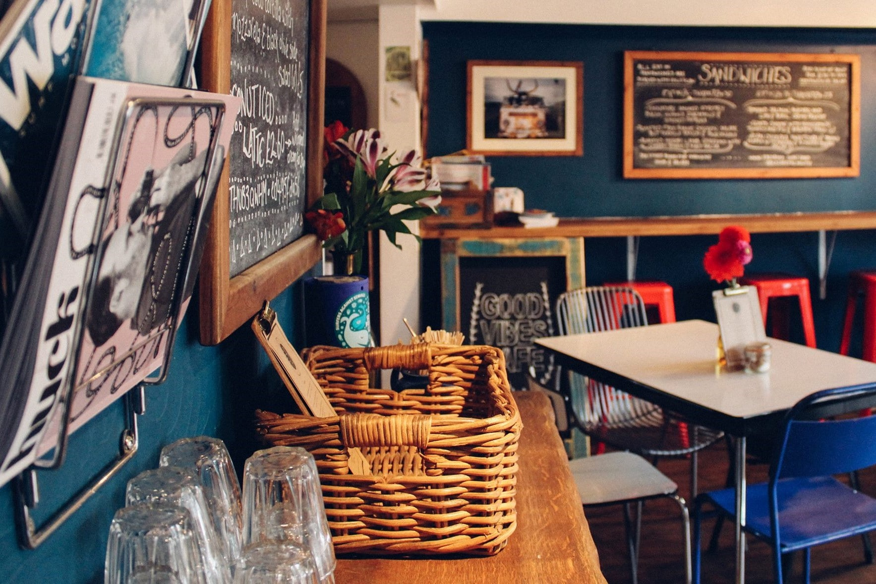 interior-of-cute-cafe-with-blue-teal-walls-good-vibes-cafe-places-to-eat-in-falmouth