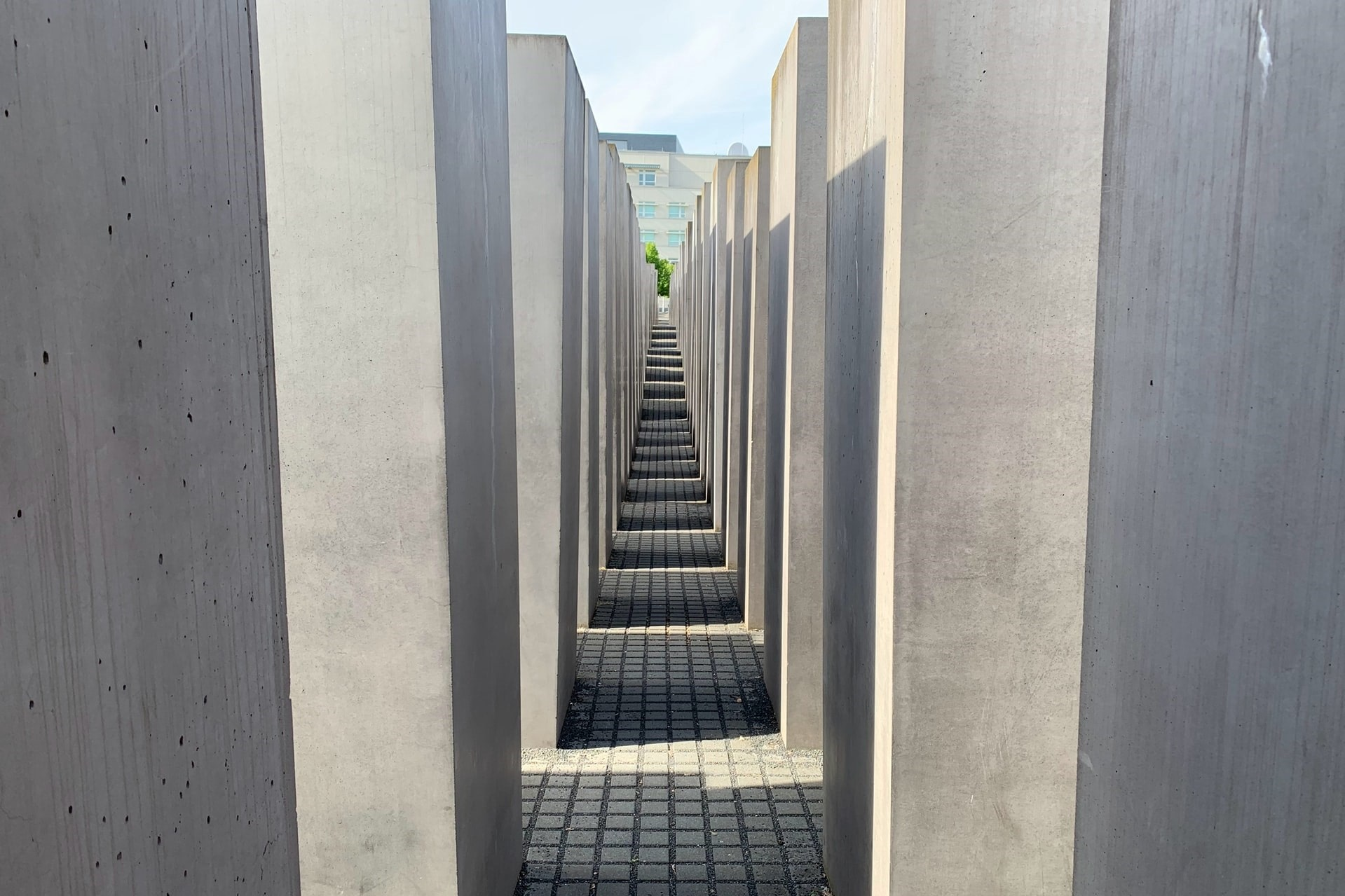 looking-down-concrete-slabs-in-outdoor-museum-memorial-to-the-murdered-jews