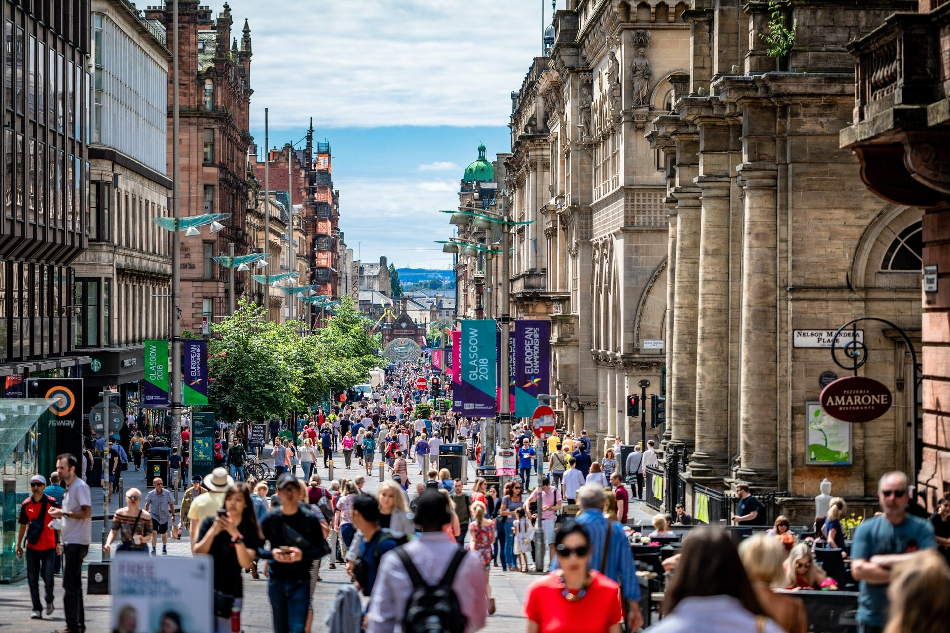 lots-of-people-walking-down-busy-city-centre-high-street-on-a-summers-day-glasgow-scotland