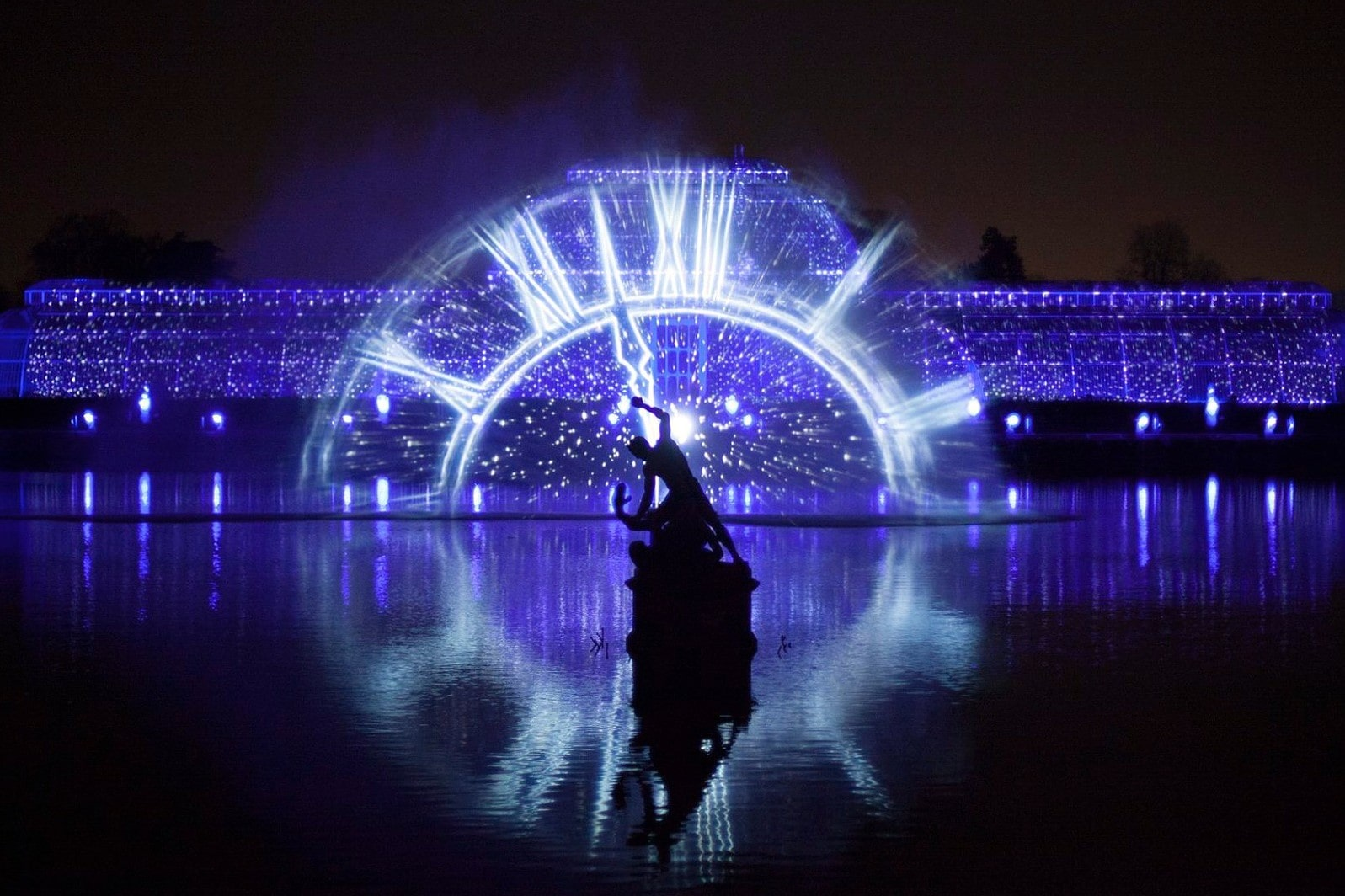 man-and-woman-dancing-at-night-in-a-lit-up-kew-gardens