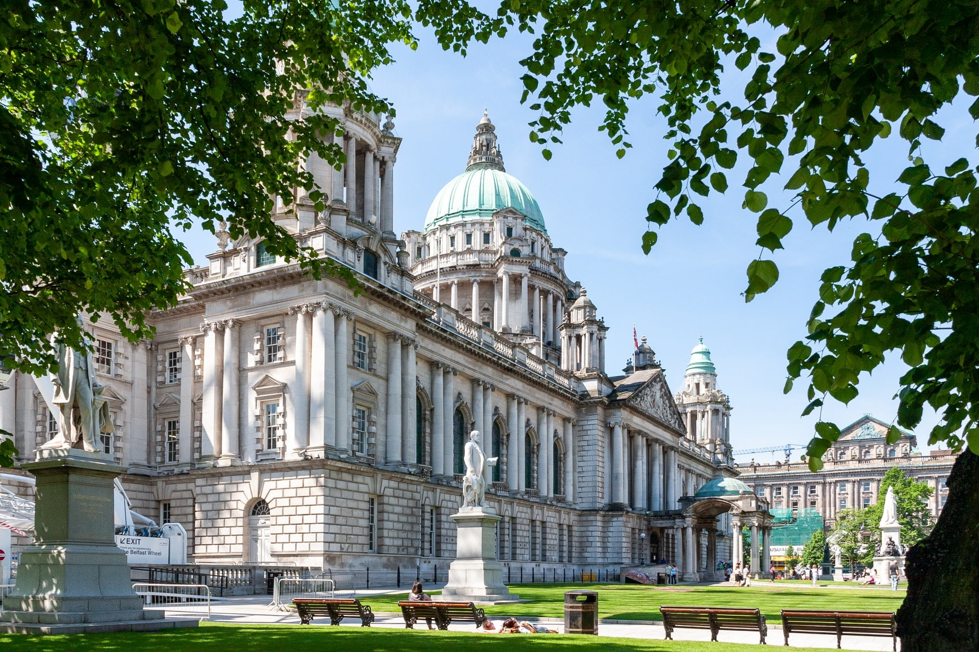 old-historic-huge-belfast-city-hall-on-a-summers-day-through-treesbest-uk-city-breaks-for-couples
