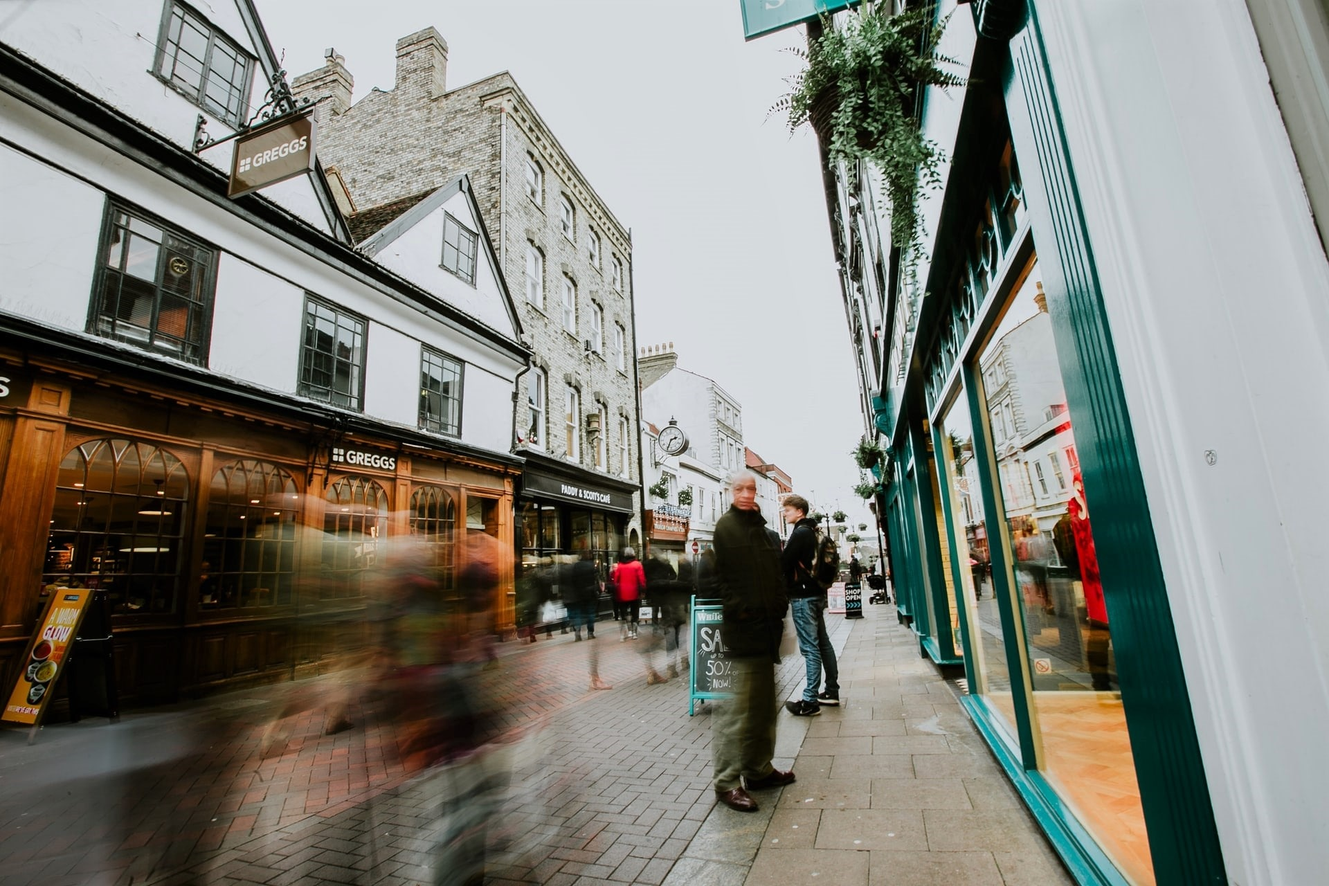 people-rushing-about-busy-british-high-street-with-a-greggs-in-bury-st-edmunds