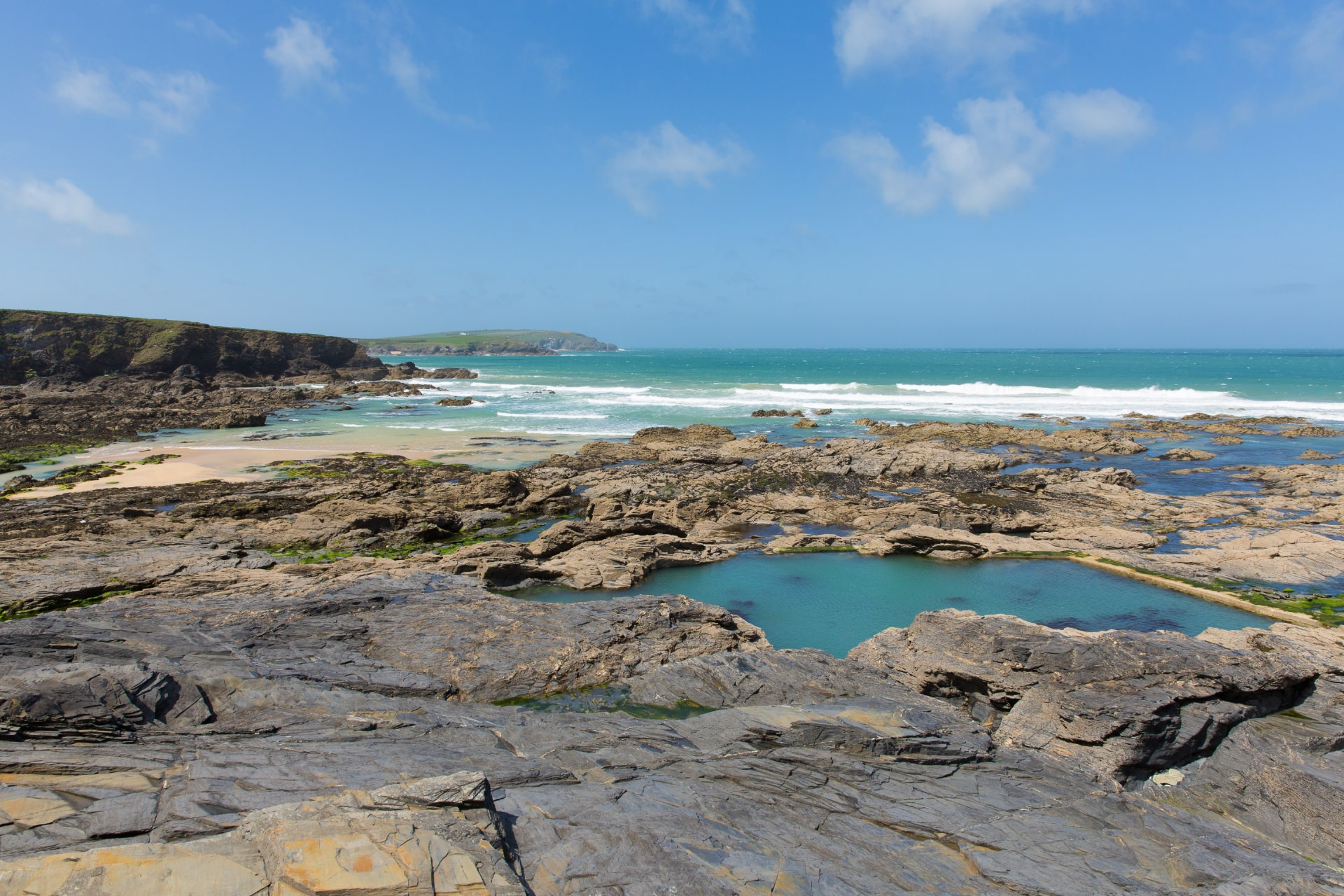 rockpools-on-beach-heading-out-to-sea-newtrain bay