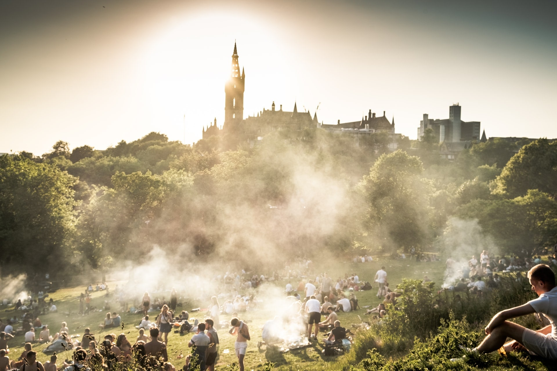 students-and-young-people-relaxing-on-grass-in-summer-on-glasgow-university-grounds-with-barbeque-smoke-everywhere-2-days-in-glasgow