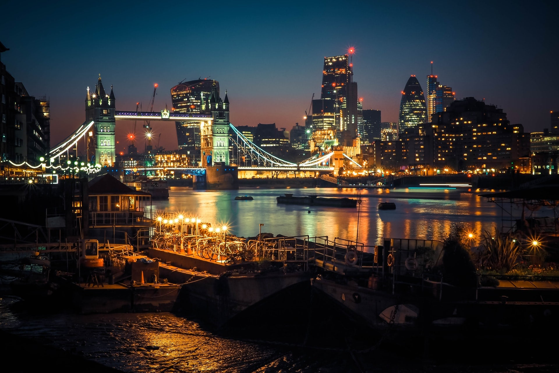 tower-bridge-at-night-lit-up-by-lights-on-the-river-thames