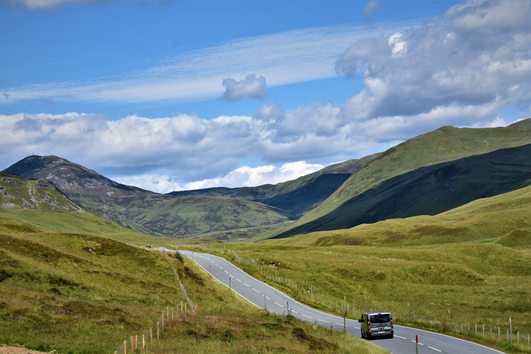 van-driving-on-road-through-mountains-in-cairngorms-national-park-scenic-drives-in-scotland