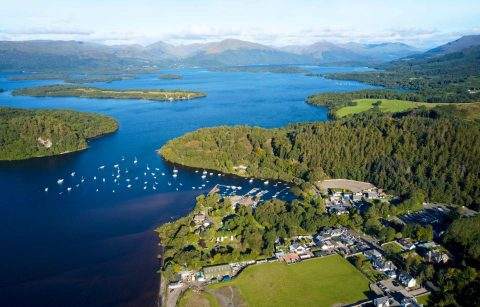 aerial-view-of-balmaha-scottish-village-lake-and-mountains-at-loch-lomond-day-trips-from-glasgow