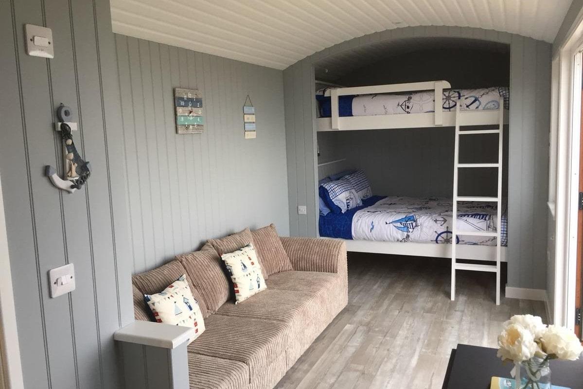 bunk-bed-and-sofa-inside-allibella-shepherds-hut