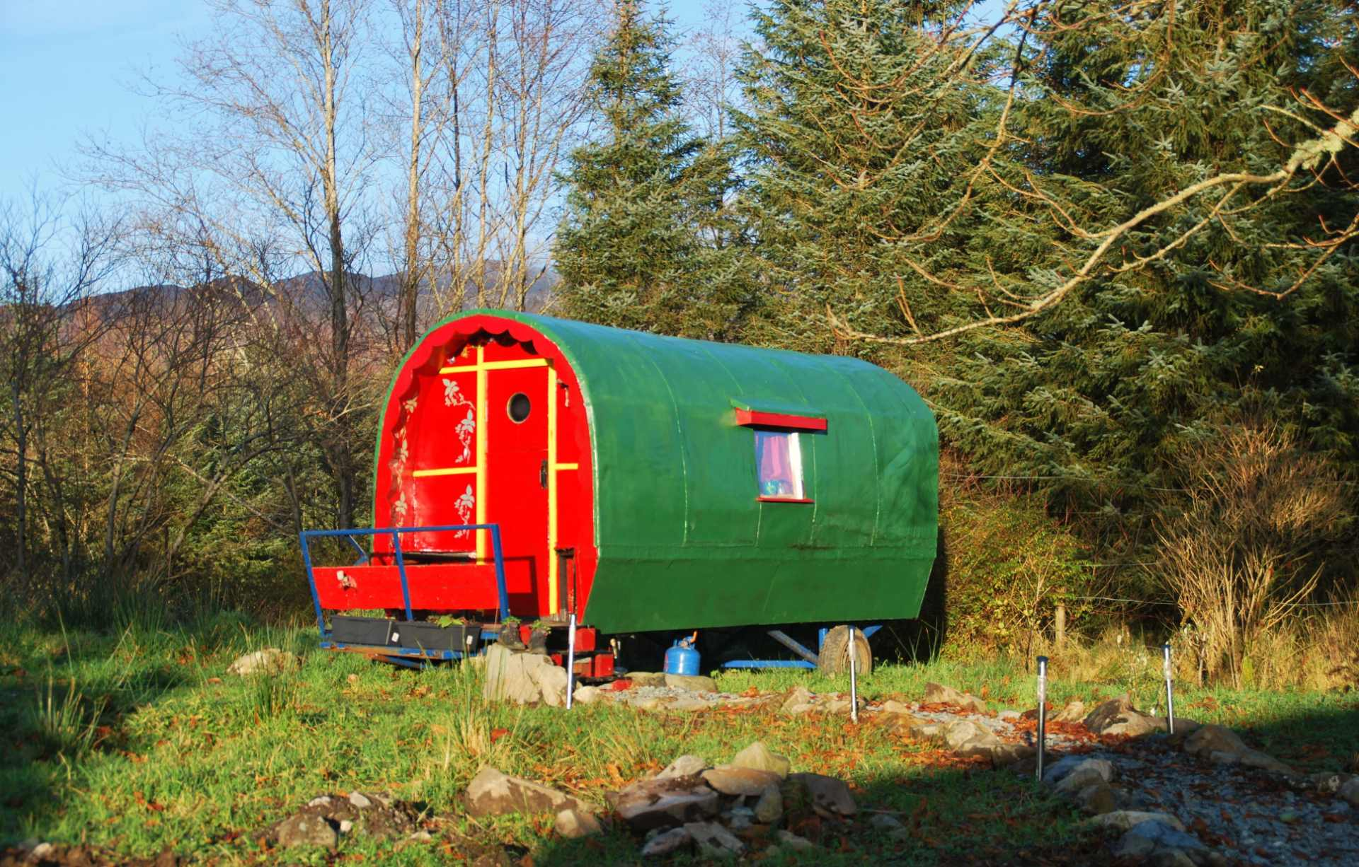 colourful-red-and-green-wonderly-wagon-in-field-and-forest