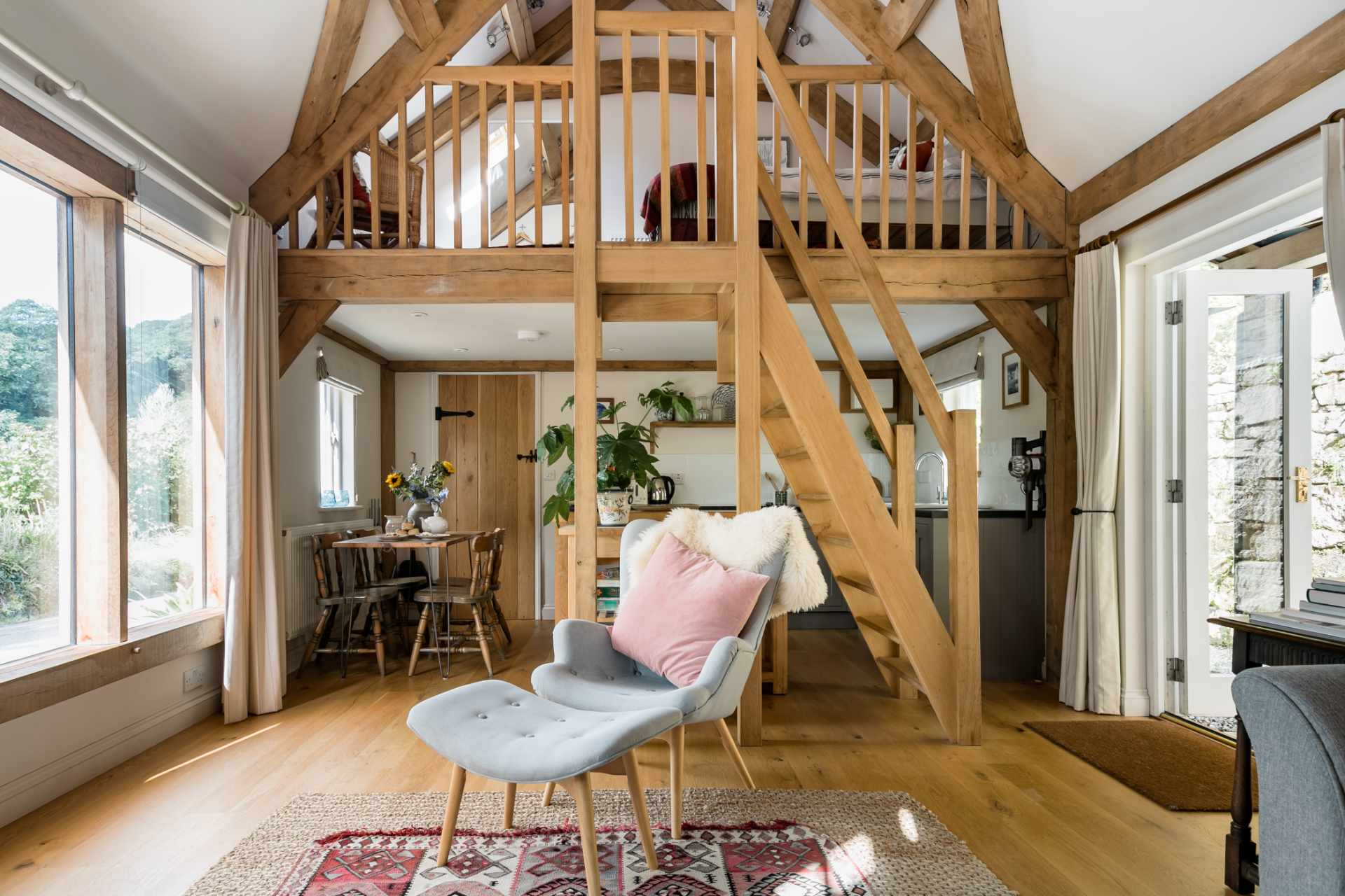 cosy-living-area-with-mezzanine-floor-in-little-trenant-barn-on-helford-river-near-constantine-best-airbnbs-in-cornwall