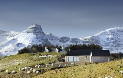 cottage-in-field-with-mountain-in-background-remote-cottages-scotland