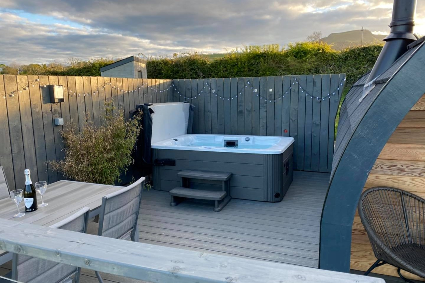 decking-with-table-and-chairs-and-hot-tub-at-sycamore-pods