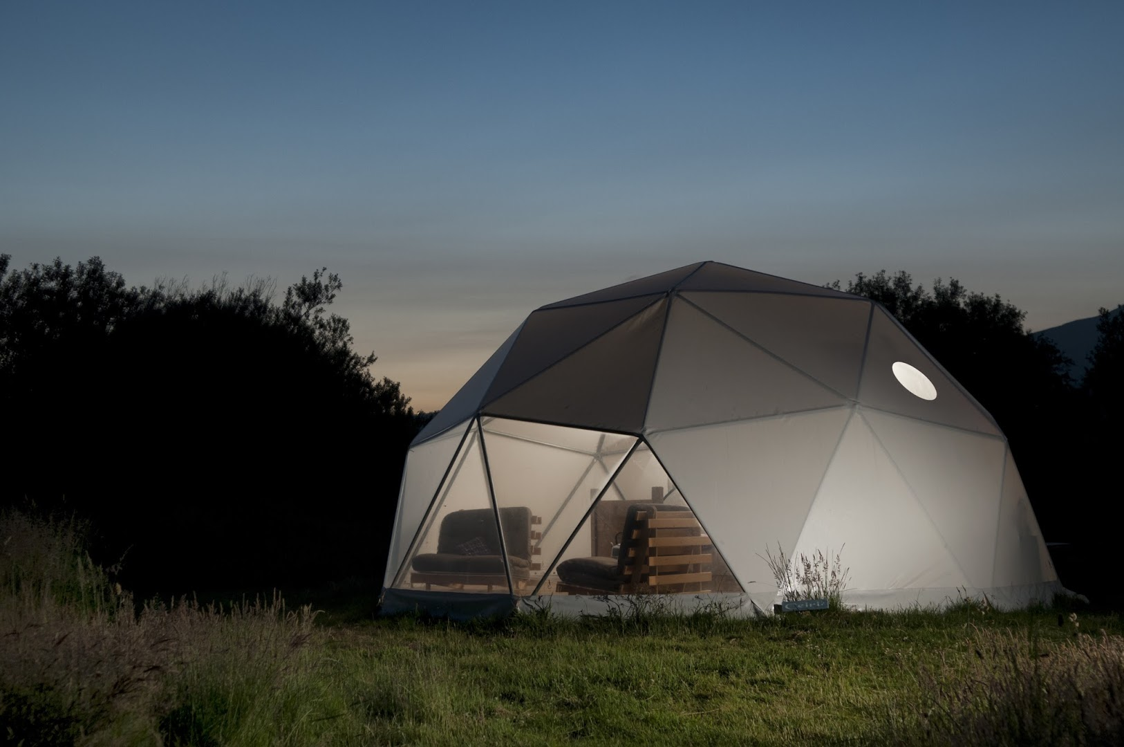 glamping-dome-lit-up-at-night-at-away-from-it-all-glamping-snowdonia