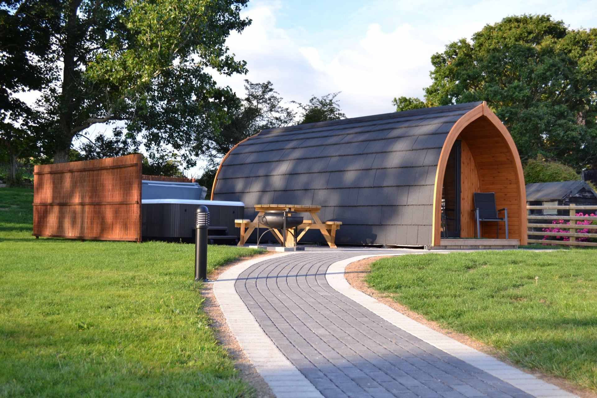 glamping-pod-with-hot-tub-picnic-table-and-bbq-at-wern-farm-glamping