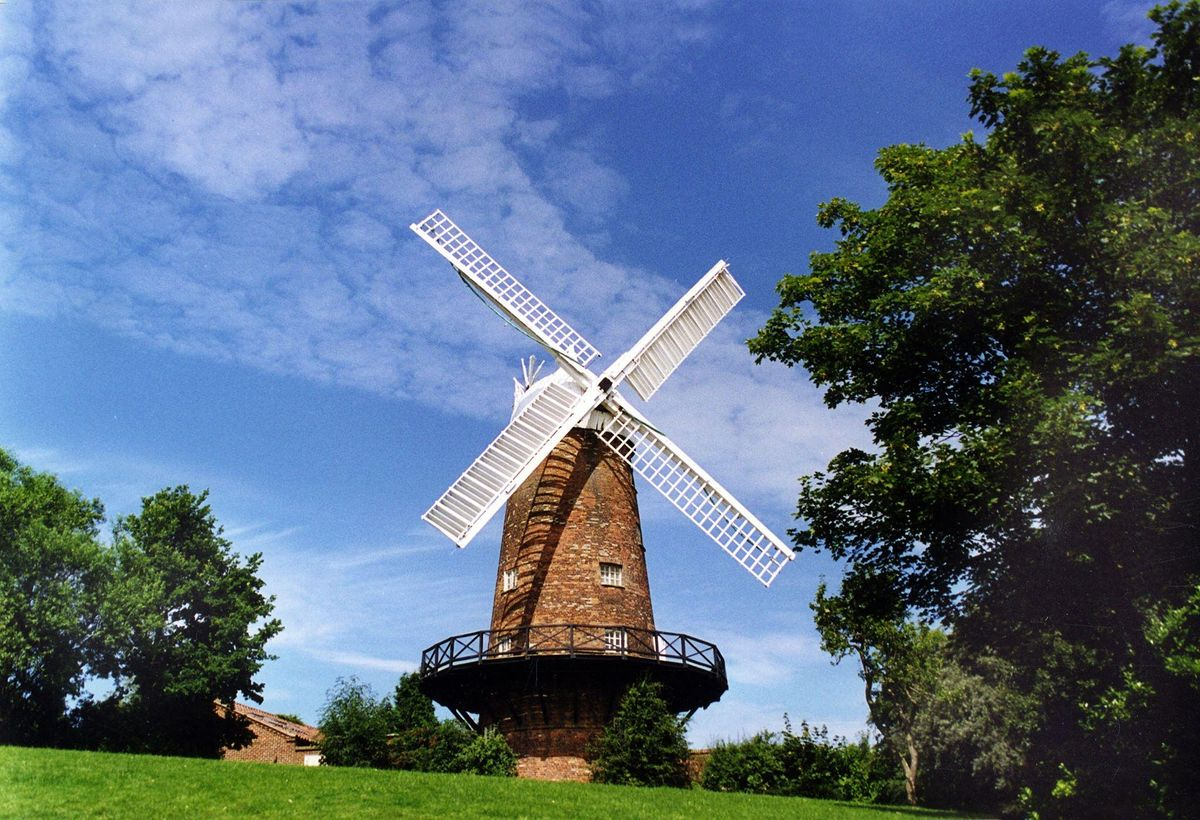 greens-windmill-sneinton-on-grassy-hill-on-sunny-day-places-to-visit-in-nottingham