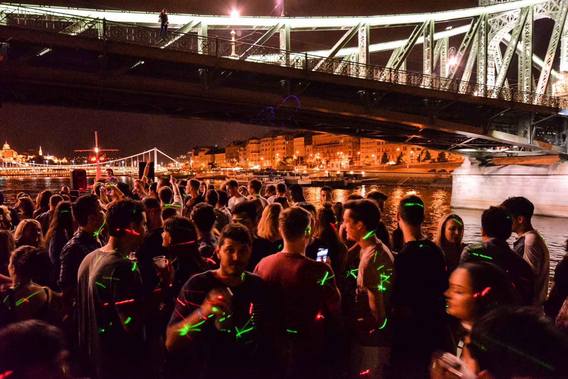 group-of-people-partying-on-a-boat-going-down-a-river-at-night-budapest-boat-party