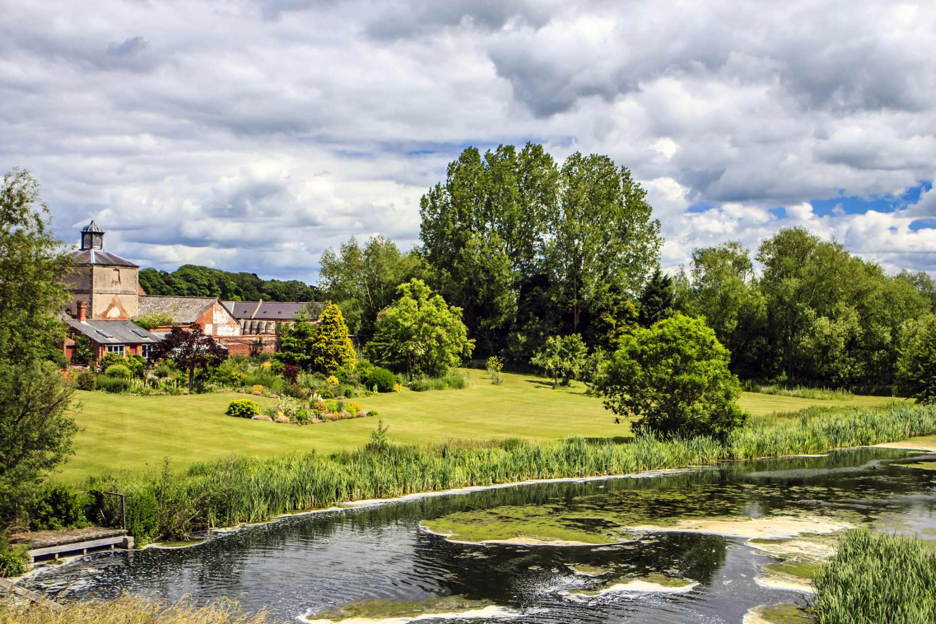 historic-house-with-green-lawn-and-pond-in-clumber park-places-to-visit-in-nottingham