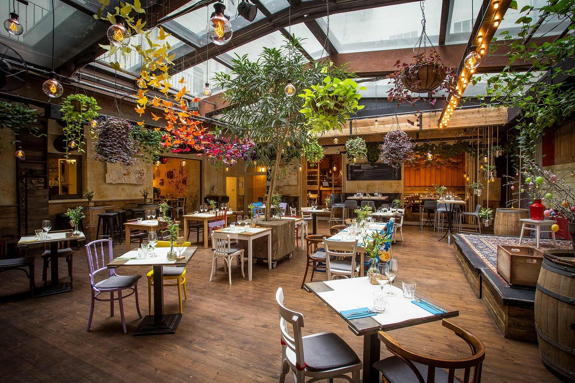 interior-of-zeller-bistro-restaurant-with-plants-coming-down-from-ceiling-4-days-in-budapest-itinerary