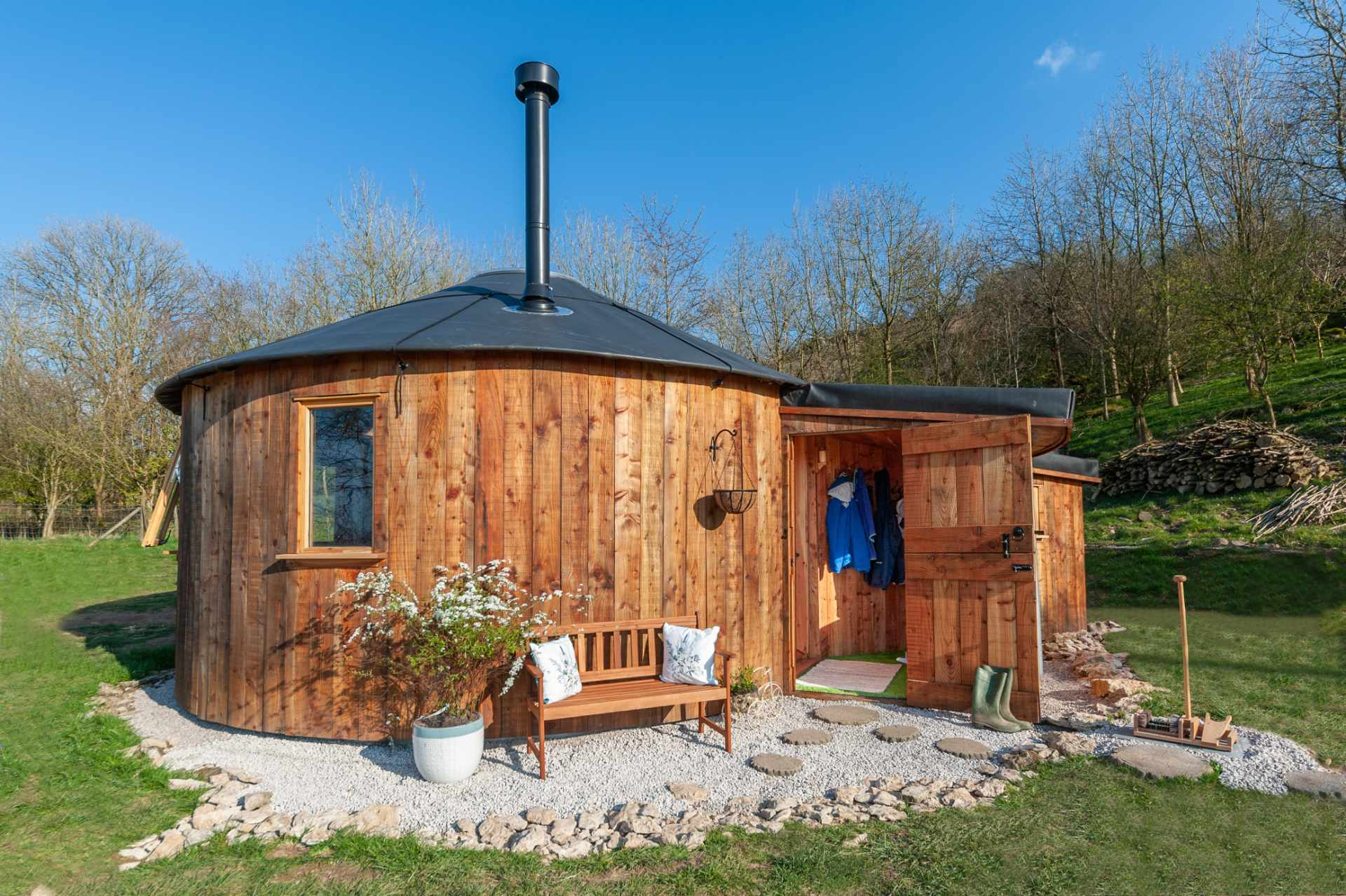 kelker-well-roundhouse-with-a-bench-in-field-with-trees-in-background--carnforth-glamping-with-hot-tub-lake-district