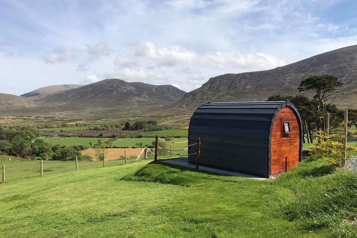large-wooden-pod-in-field-overlooking-mountains-at-gorse-hill-farm