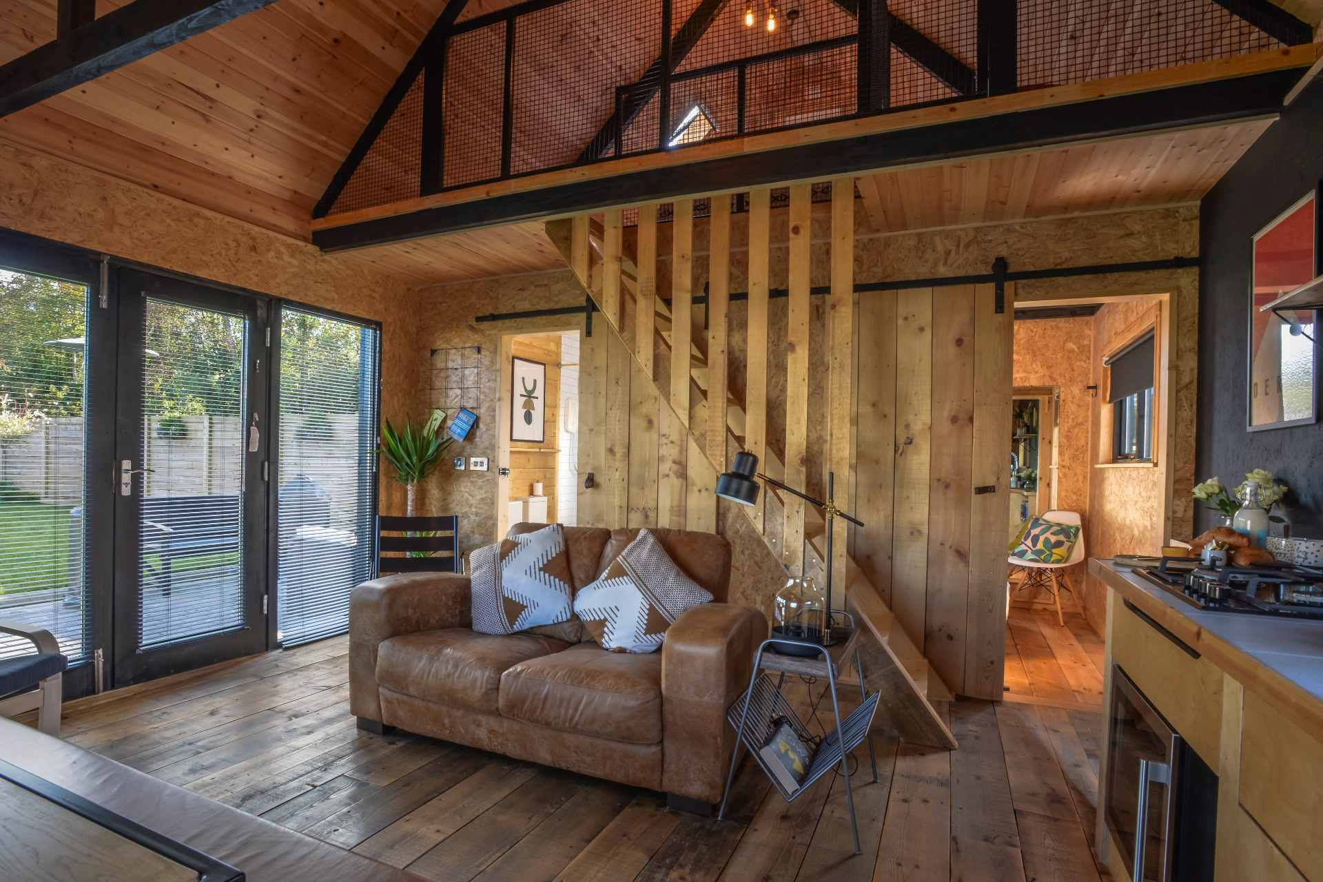 living-space-of-wooden-cabin-the-black-shack-bancran-school-tiny-house-glamping-northern-ireland