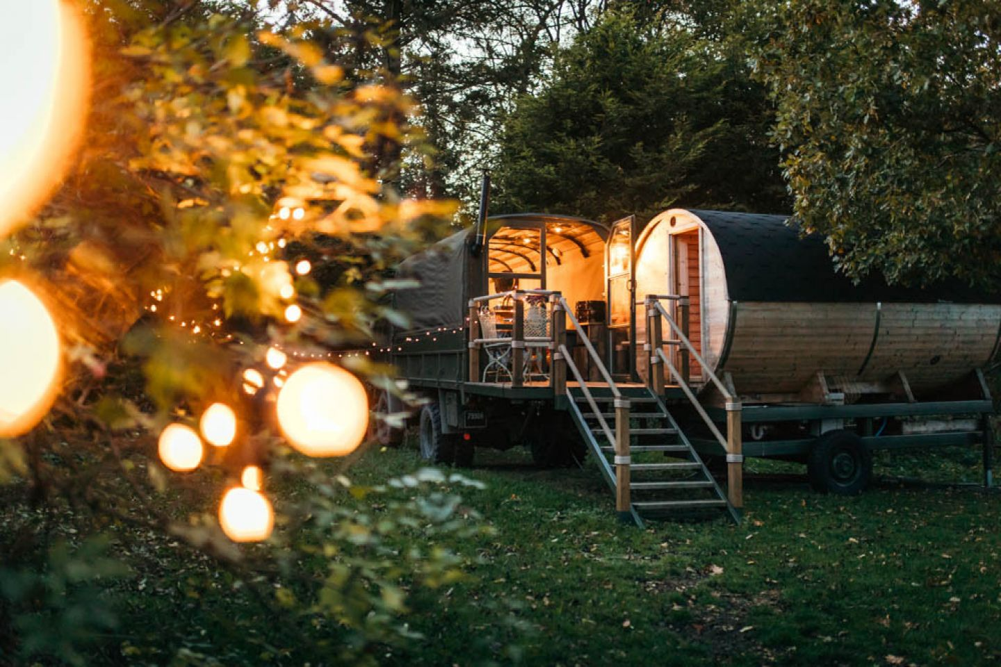luxury-myrtle-glamping-truck-surrounded-by-fairy-lights-in-garden-glamping-northern-ireland