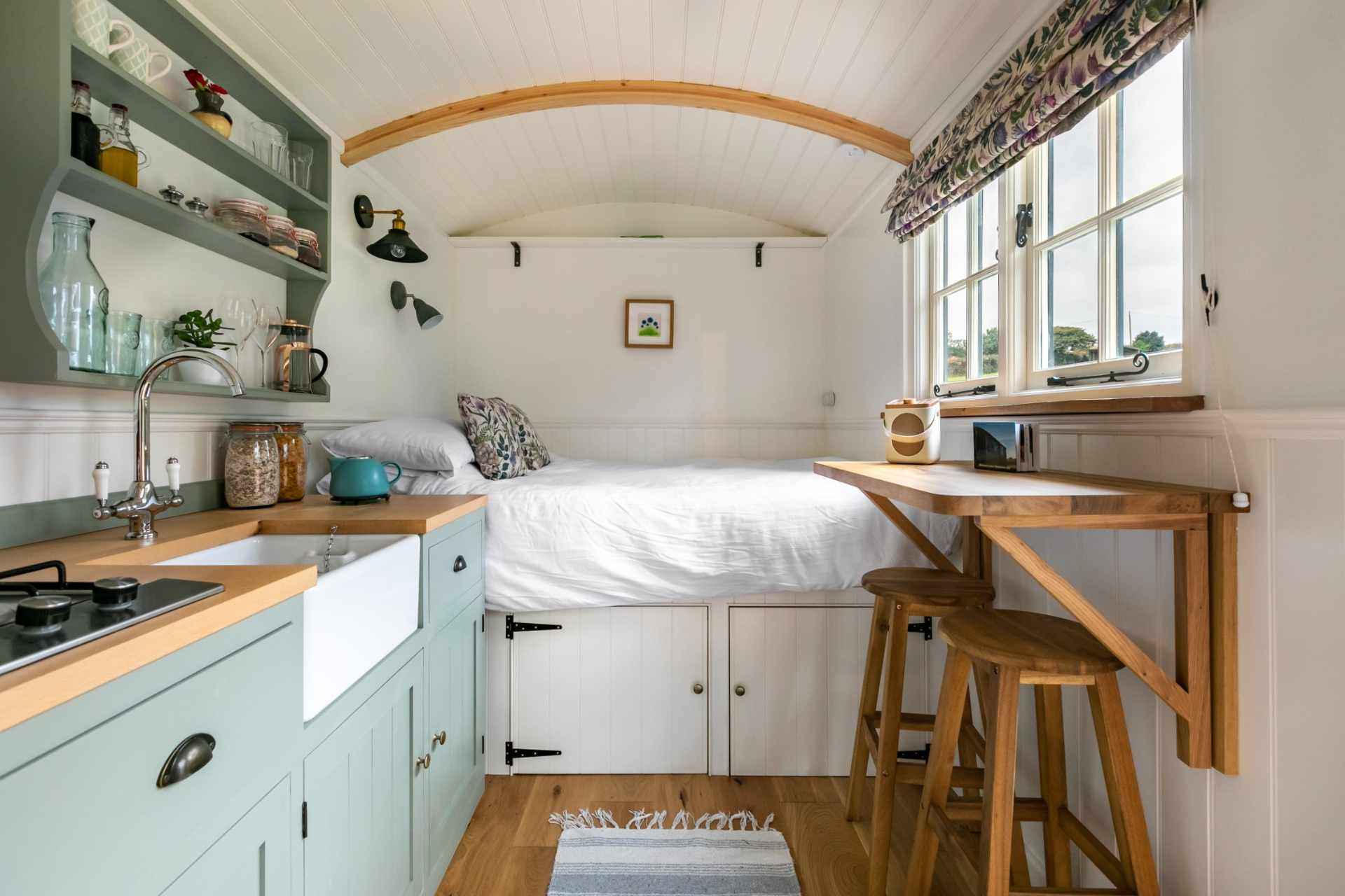 minimalist-shepherds-hut-with-white-bedding-and-mint-countertops-in-falmouth-best-airbnbs-in-cornwall