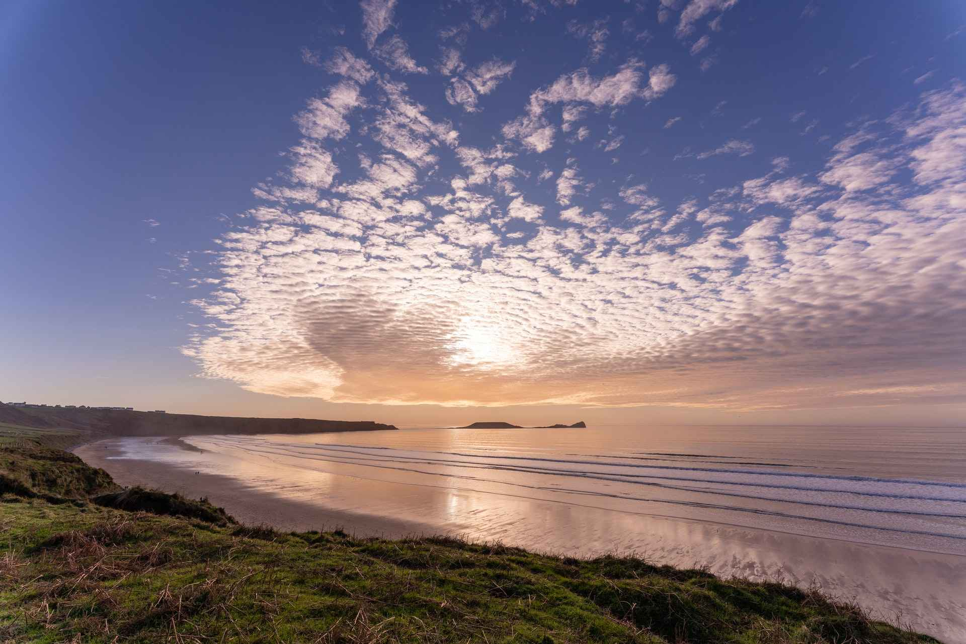 stratus-clouds-at-sundown-over-worms-head-on-the-gower-peninsula-days-out-in-south-wales