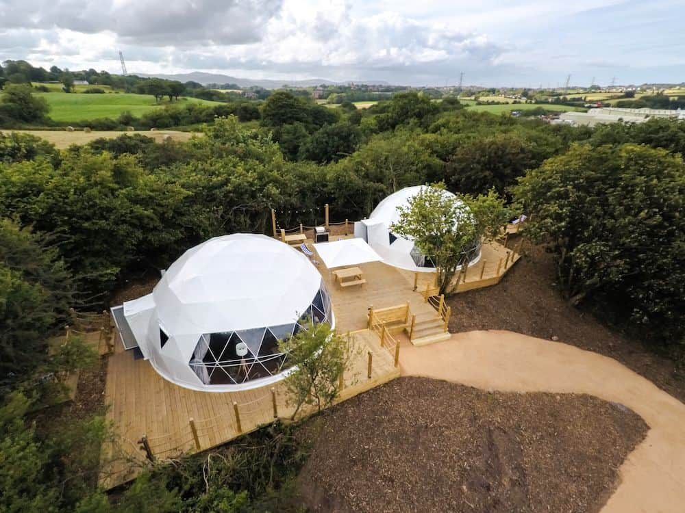 two-white-geodomes-on-decking-in-forest-at-lets-go-hydro-glamping-northern-ireland