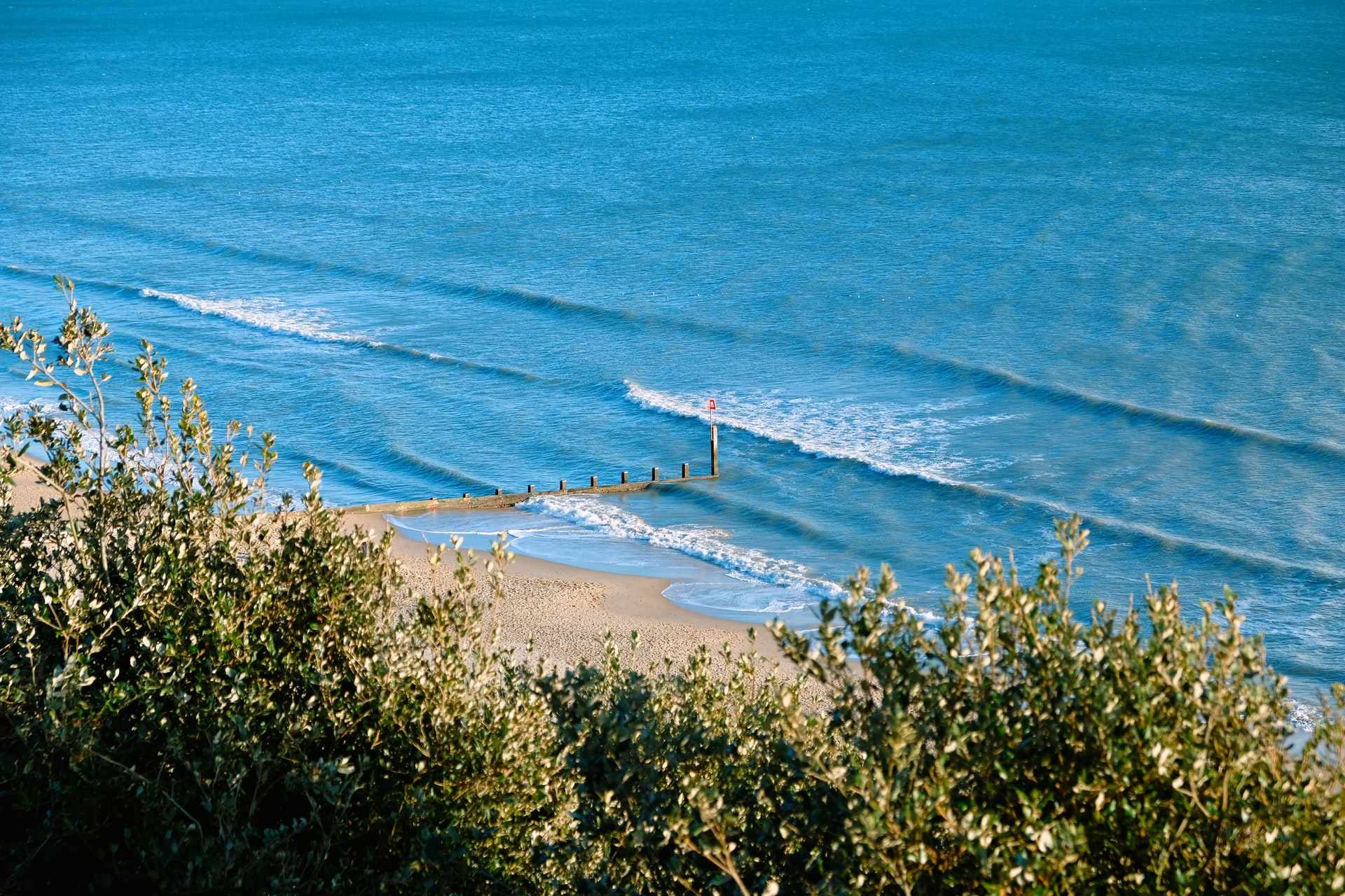 view-of-beach-and-blue-sea-from-above-in-bournemouth-days-out-in-dorset