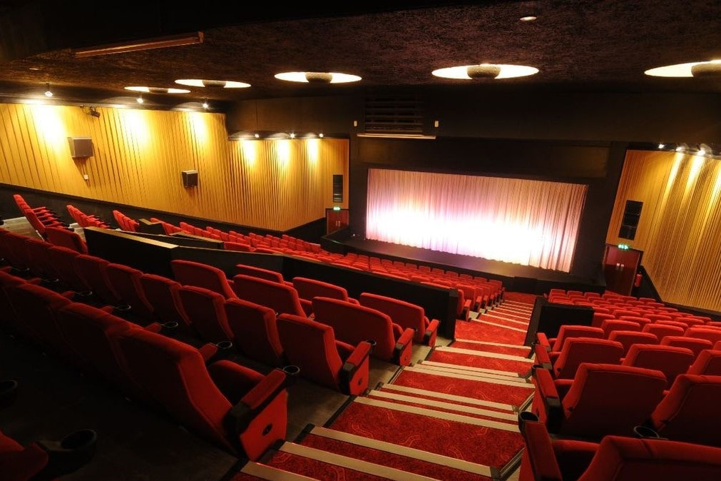 view-of-savoy-cinema-screen-and-red-seats-from-top-of-steps