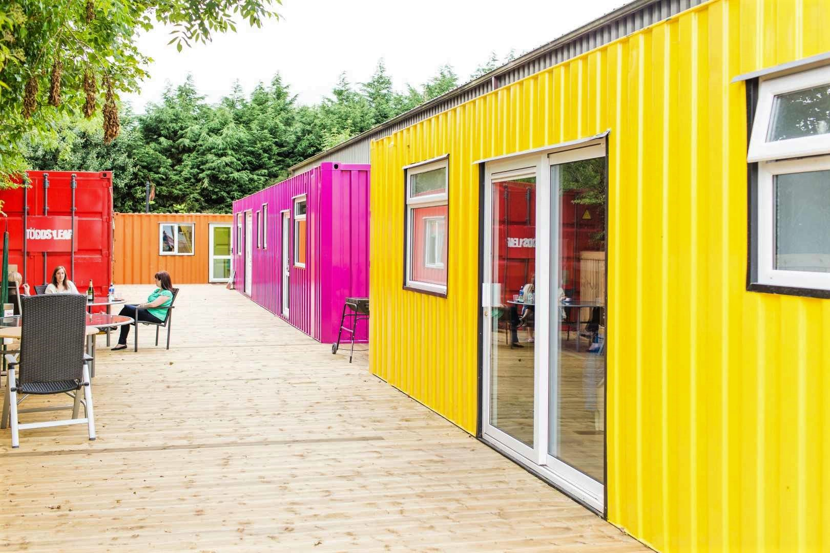 yellow-and-pink-glamping-snooze-boxes-containers-at-todds-leap