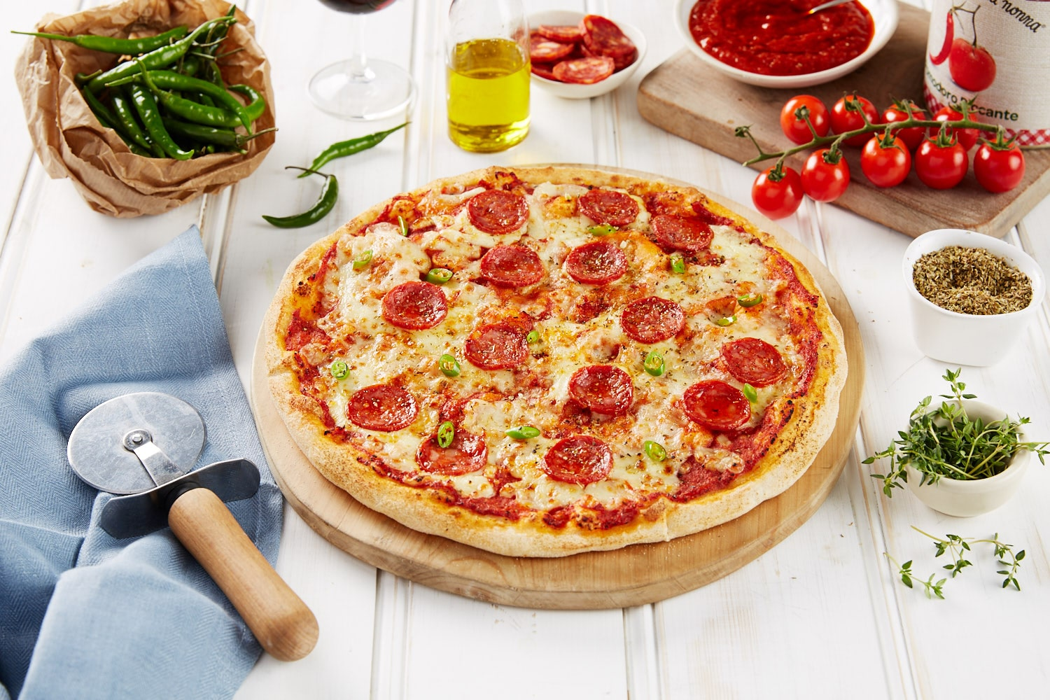 bella-italia-pepperoni-pizza-on-wooden-board-on-white-table
