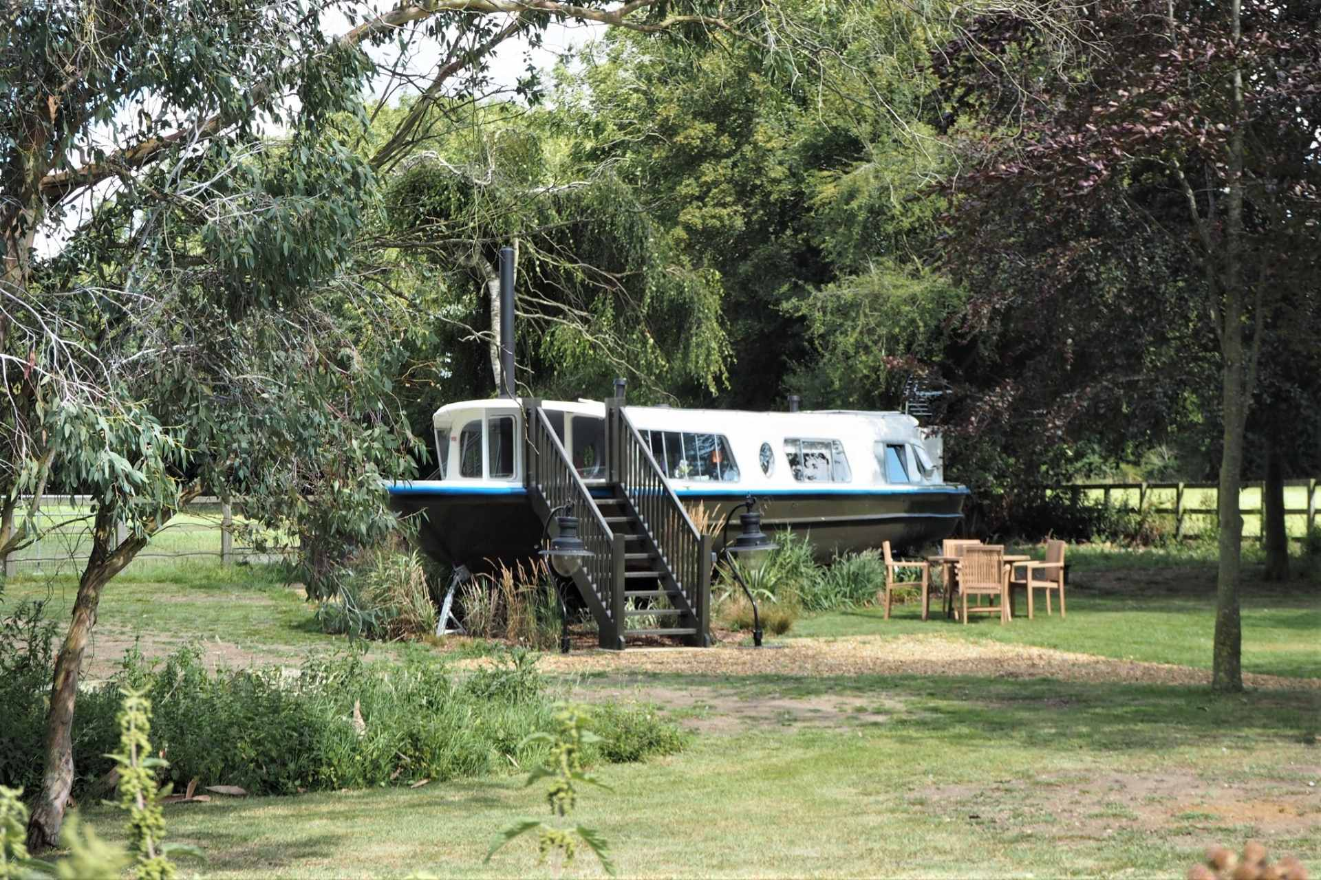 black-white-and-blue-woodland-boat-in-field-in-hingham