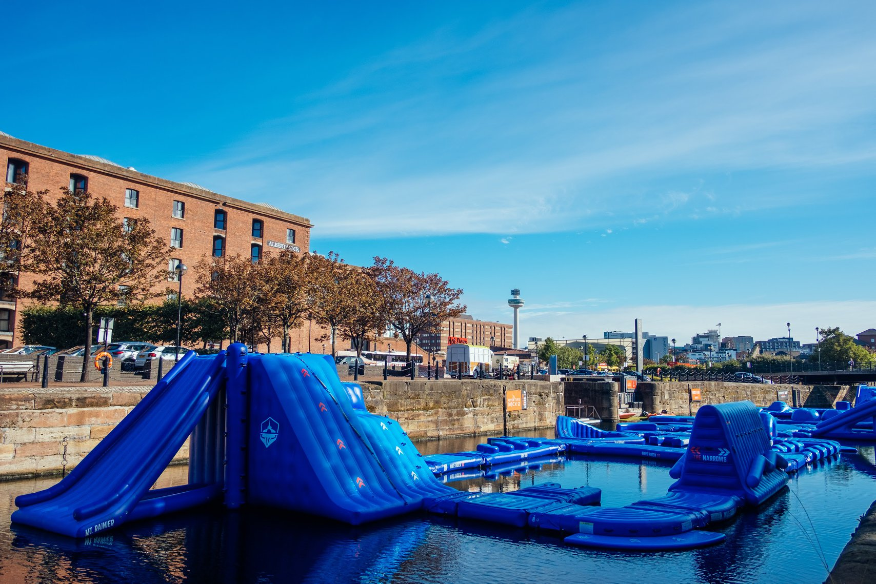 blue-inflatable-obstacle-course-on-river-by-city-street-date-ideas-liverpool
