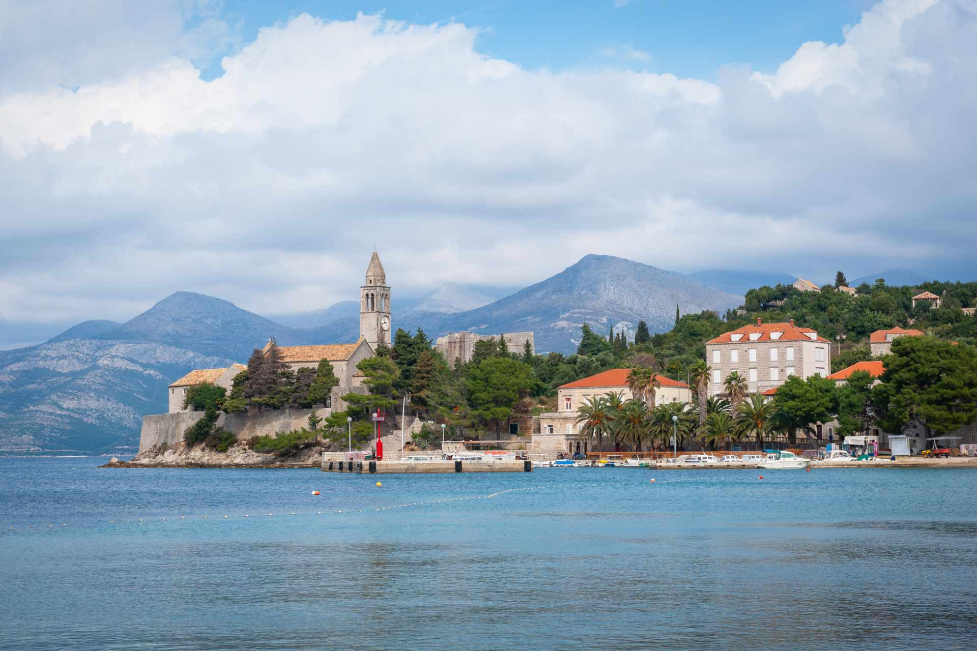 blue-sea-leading-to-franciscan-monastery-on-lopud-island-with-mountains-in-background-3-days-in-dubrovnik-itinerary