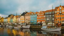 boats-docked-by-colourful-nyhavn-harbour-houses-3-days-in-copenhagen-itinerary