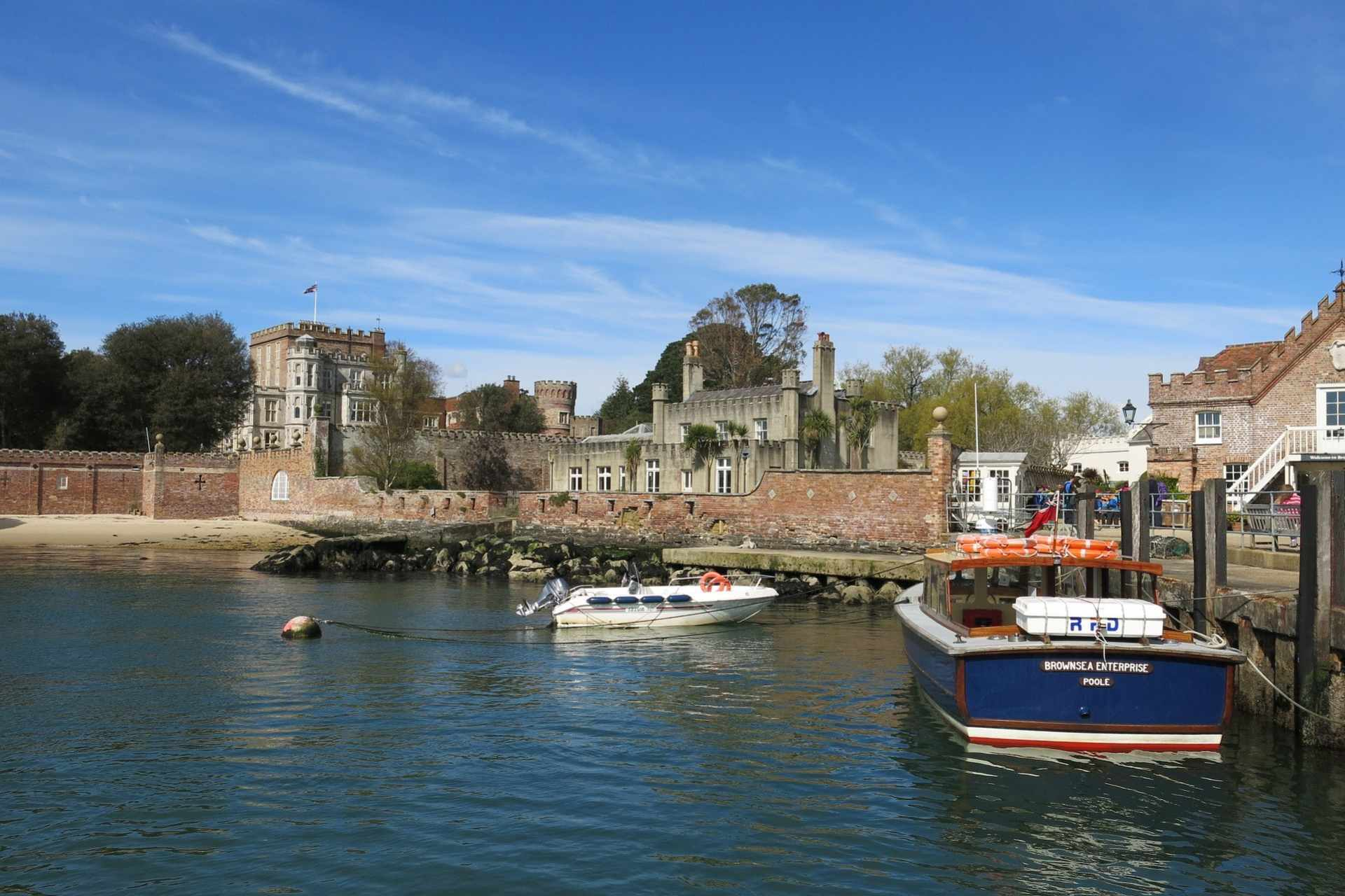 brownsea-island-castle-by-harbour-on-sunny-day-with-blue-skies