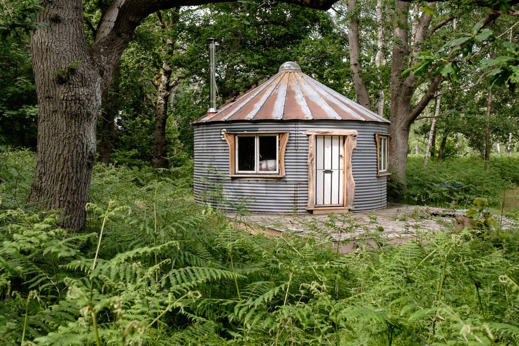 circular-hut-in-bradmoor-woods-camp-in-daytime