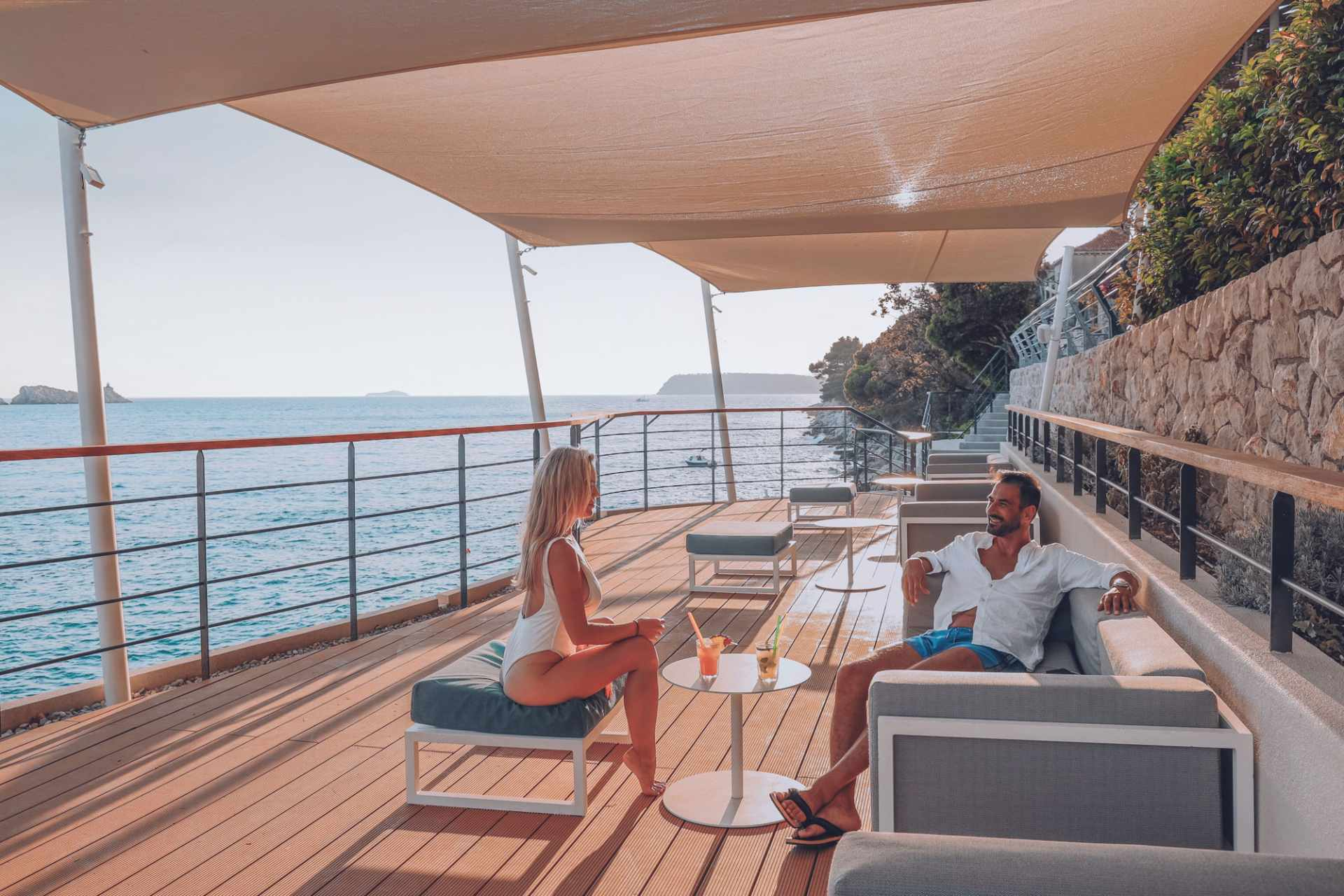 couple-enjoying-drinks-at-sunset-at-cafe-bar-more-by-sea-3-days-in-dubrovnik-itinerary