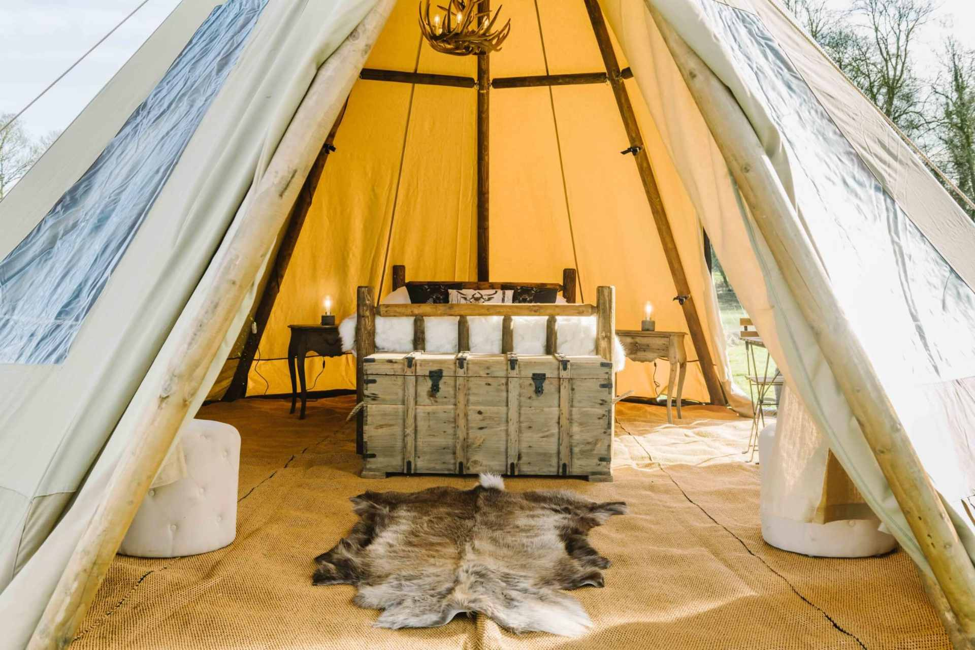 double-bed-and-rug-inside-large-cloud-nine-tipi