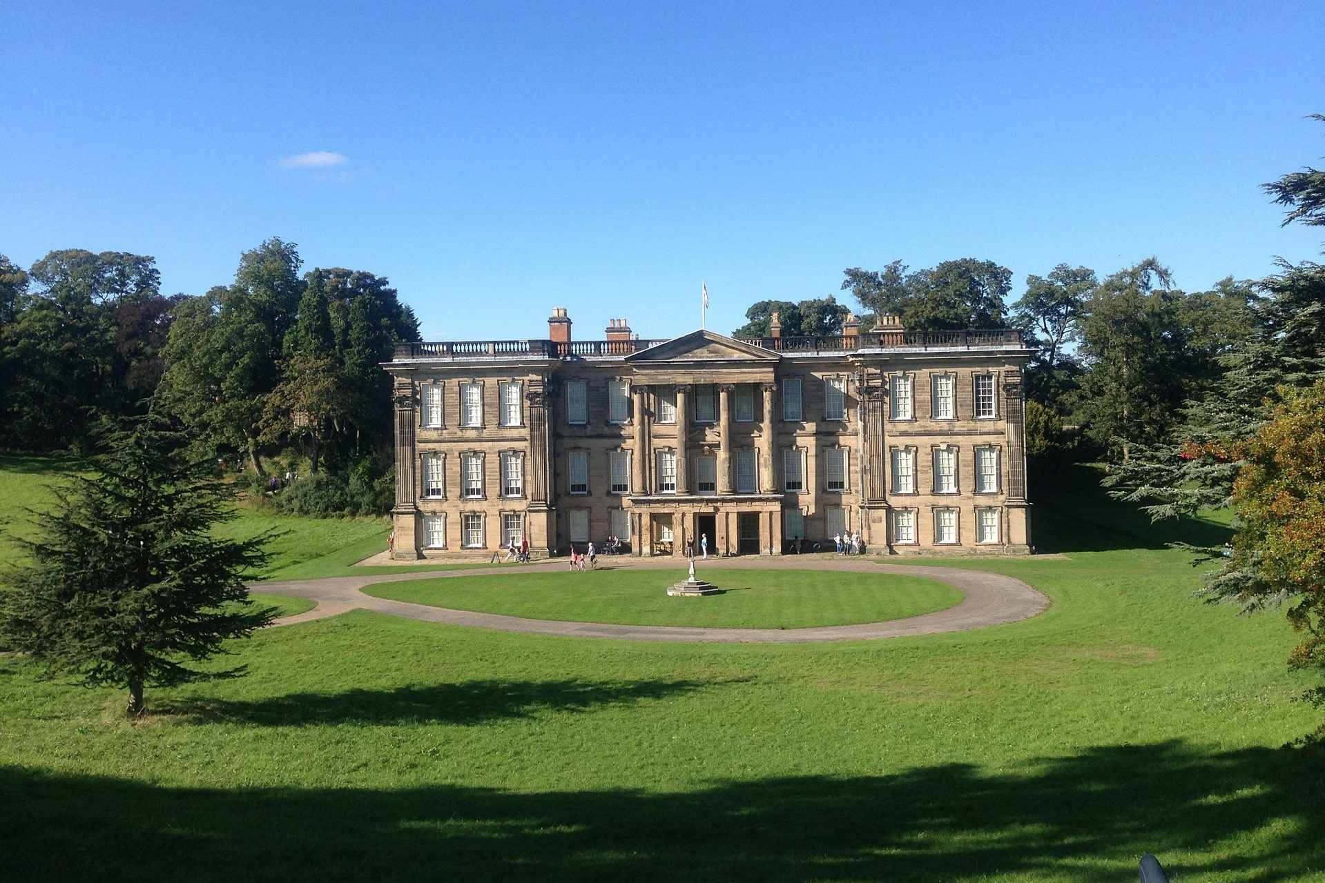 grand-calke-abbey-in-green-grounds-on-sunny-day-day-trips-from-derby