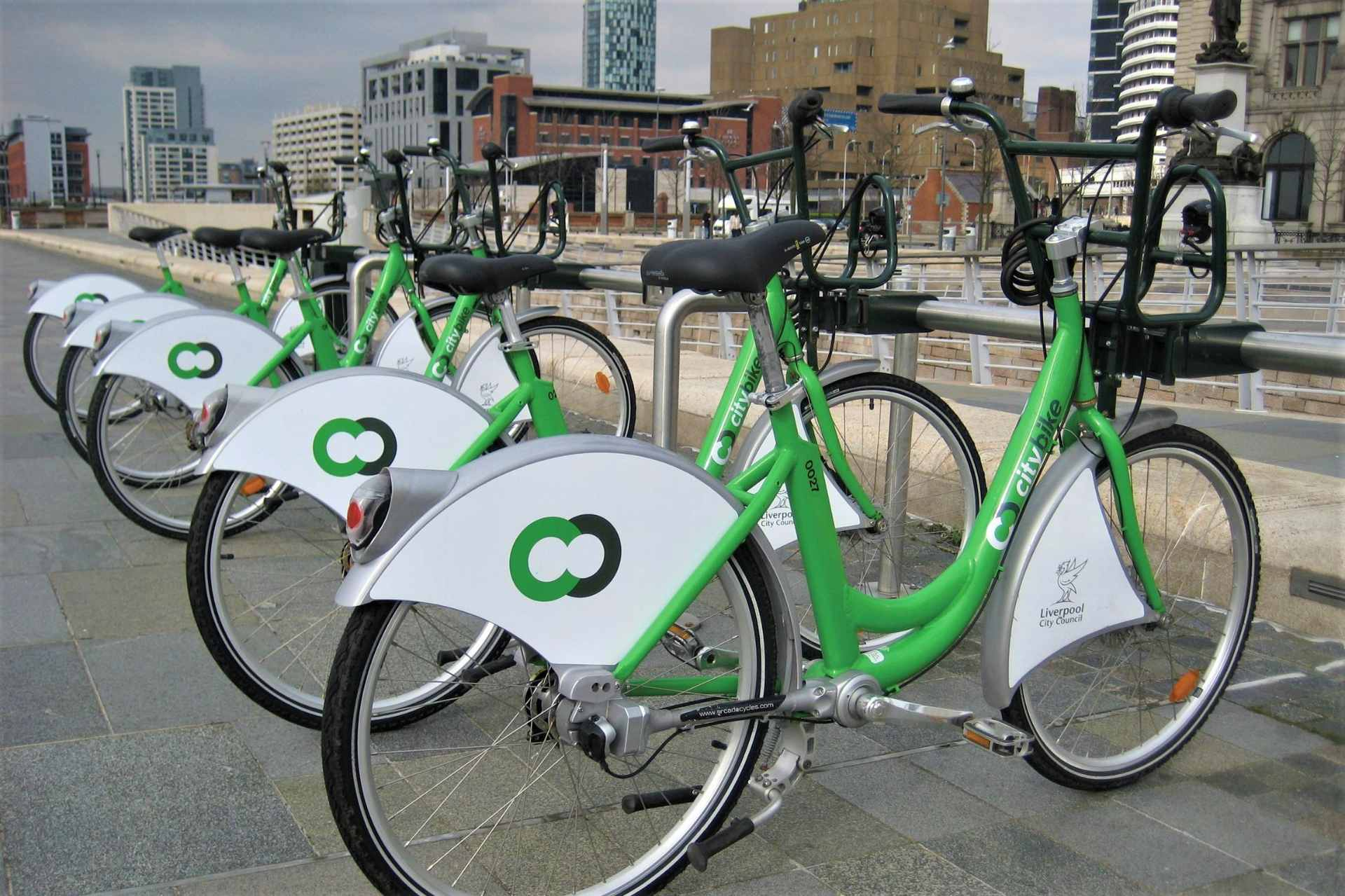 green-liverpool-citybike-bikes-for-hire-lined-up-on-grey-day