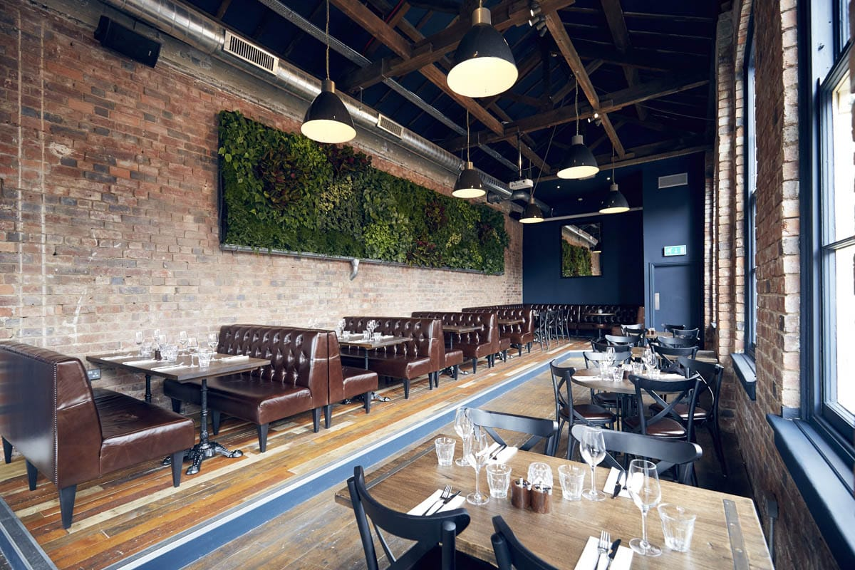 interior-of-the-button-factory-restaurant-with-exposed-brick-walls-tables-sofas-and-chairs