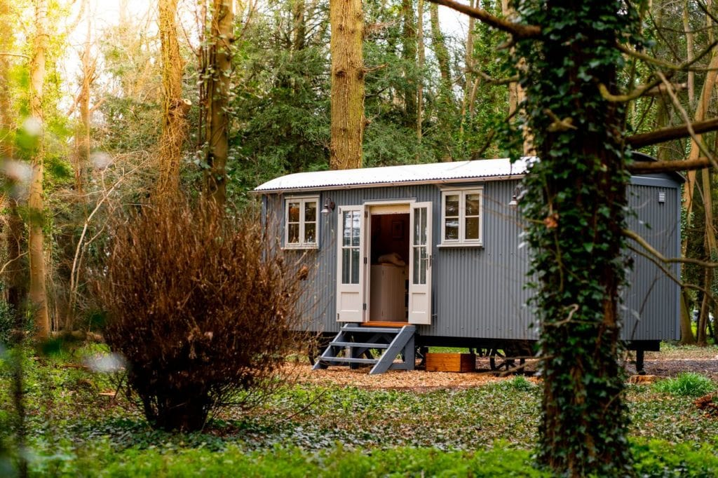 large-grey-shepherds-hut-in-forest-at-ketteringham-hall-glamping-norfolk