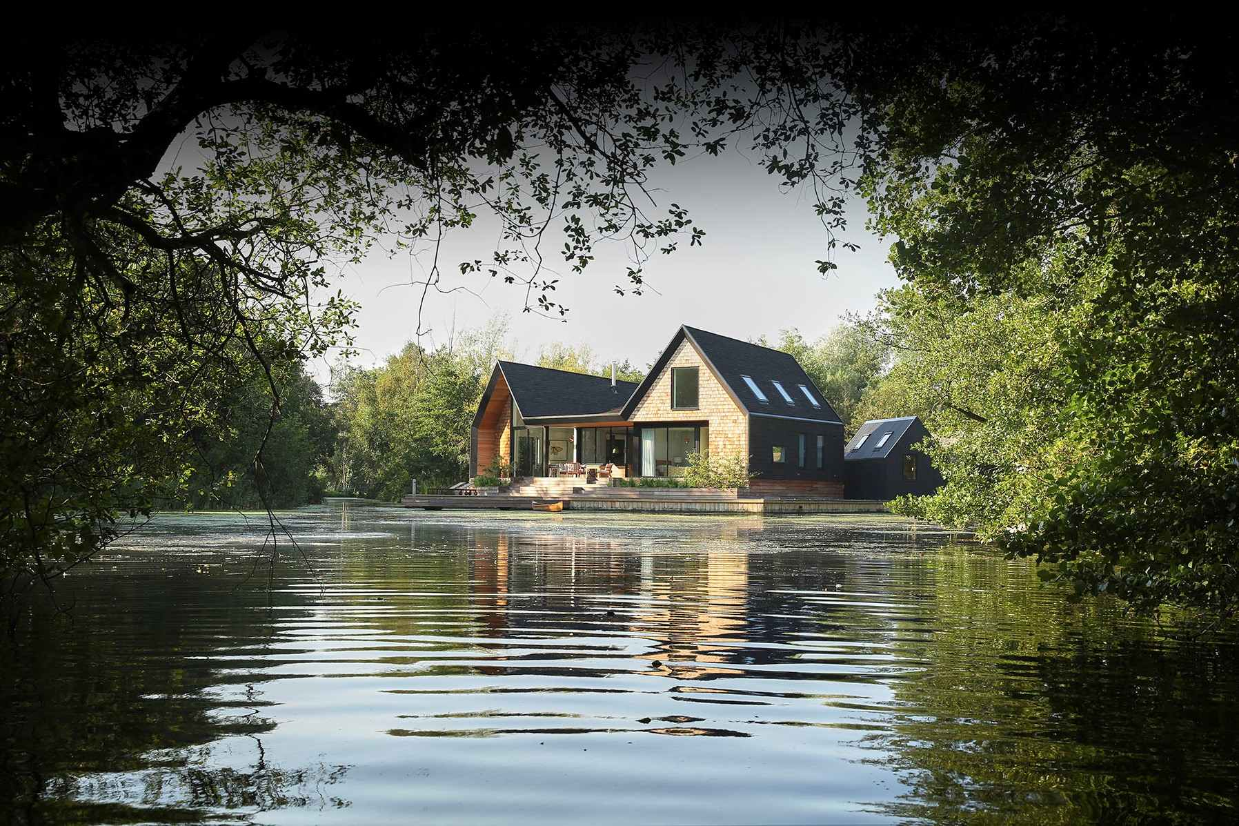 large-modern-backwater-cabin-with-decking-on-lake