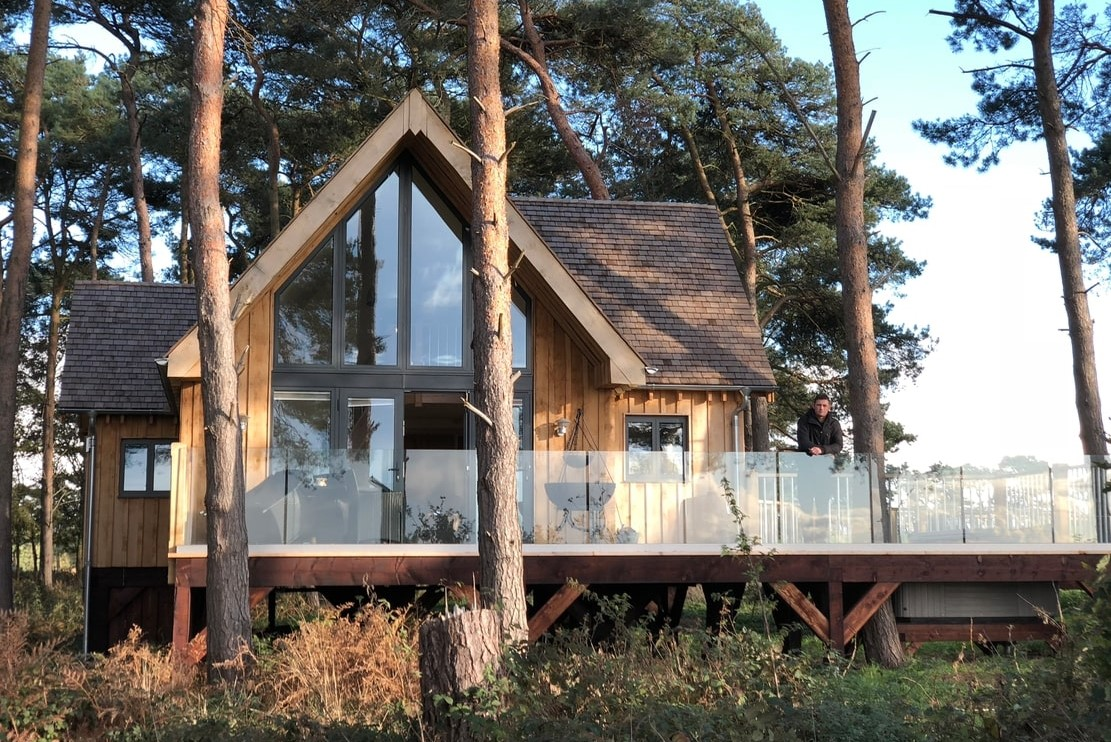 large-treehouse-with-decking-in-forest-toad-hall-treehouse-at-happy-valley-norfolk-glamping-norfolk