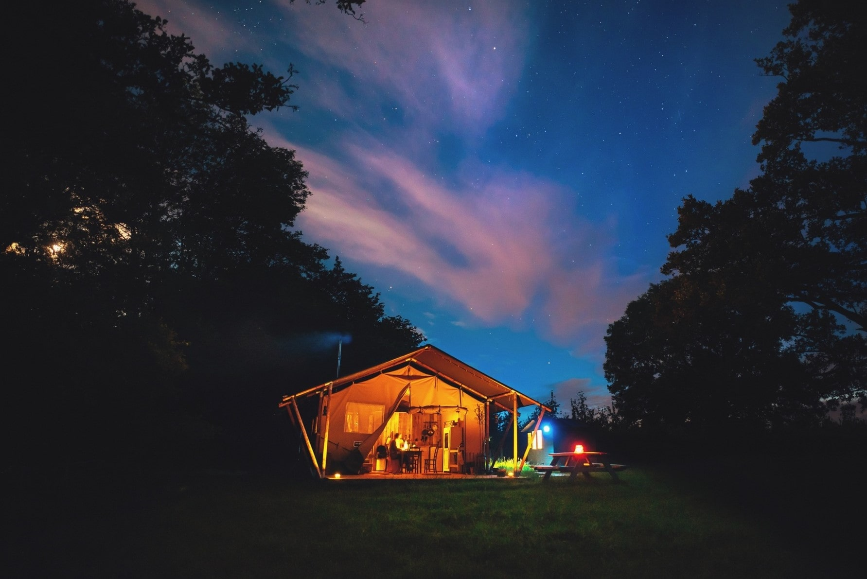 maddle-brook-safari-tent-in-field-lit-up-at-night-glamping-herefordshire