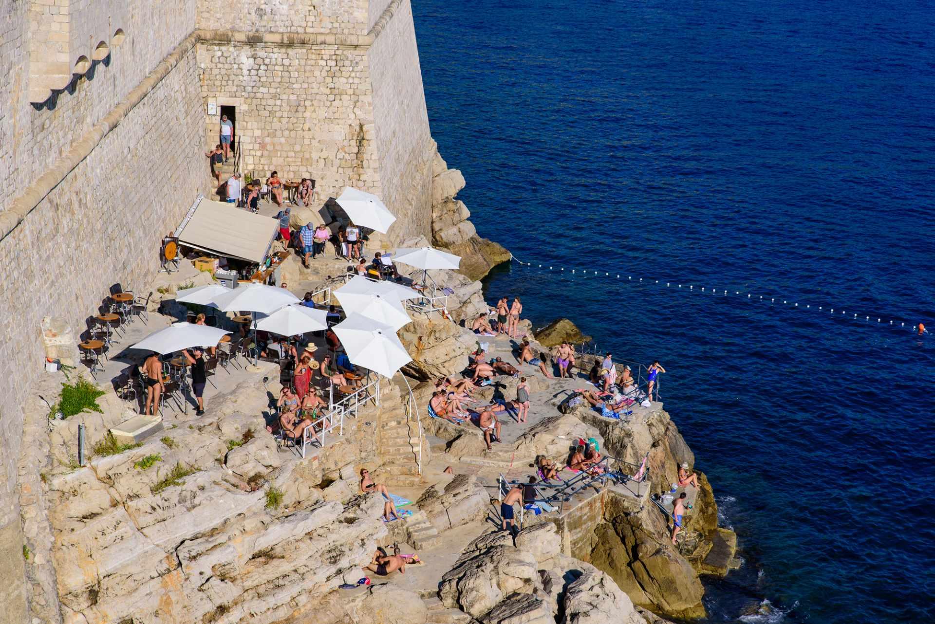 people-drinking-in-sun-in-cliffside-buža-bar-3-days-in-dubrovnik-itinerary