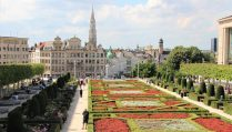 people-walking-in-park-by-flowers-in-daytime-with-historic-buildings-in-background-2-days-in-brussels-itinerary